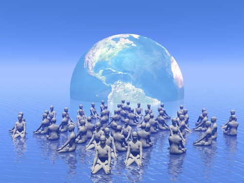 Many human beings meditating for earth
